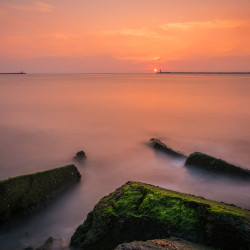 IJmuiden, NL - Sunset on the rocks